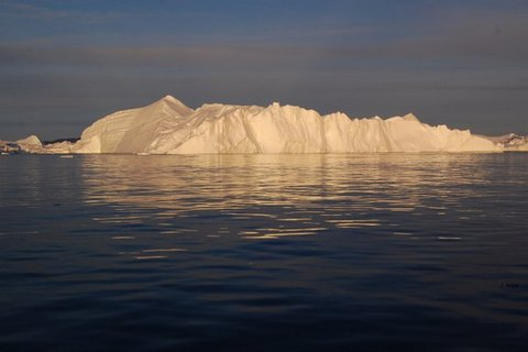 Ice berg in midnight sun in the Icefjord, Greenland